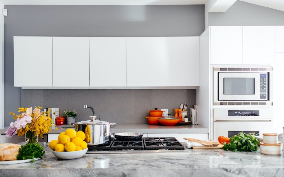 Learn how to hang kitchen cabinets like a pro